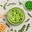 Velvety pea soup with herb croutons