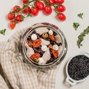 Black rice, tuna in oil, confit cherry tomatoes, olives and cream cheese